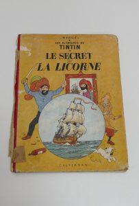 g-BD-Tintin-coiffe-retouche-couleur-couture-le-secret-de-la-licorne-bande-dessinnees_atelier-restauration-papier