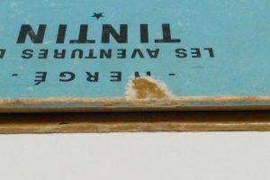 o-BD-Tintin-coiffe-retouche-couleur-dechirure-lacune-dos-objectif-lune-bande-dessinnees_atelier-restauration-papier
